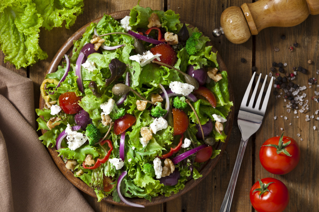 Spring salad shot from above on rustic wood table