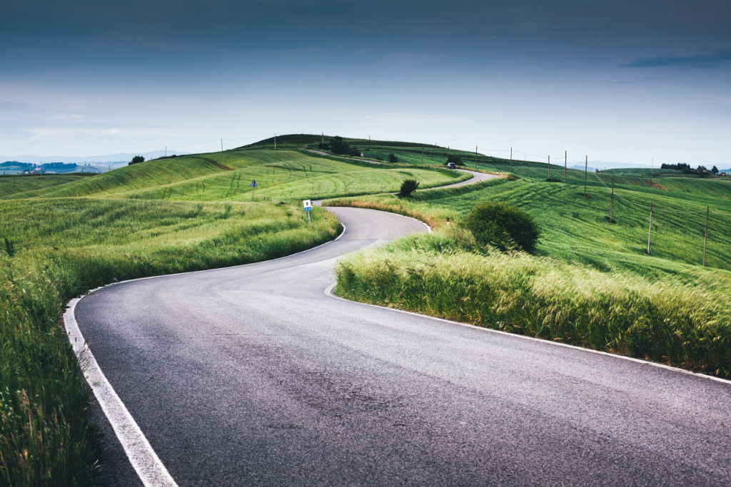 Winding road over Tuscany hills (Val D'orcia, Italy).