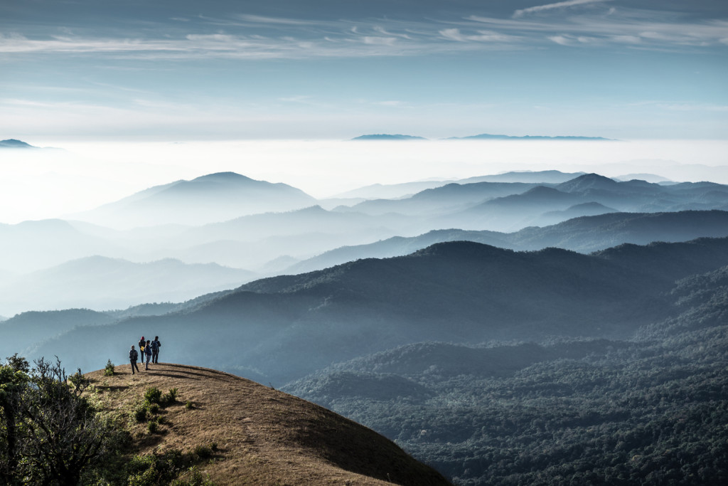 Trekkers standing on the hill, Monjong, Chiang Mai, Thailand