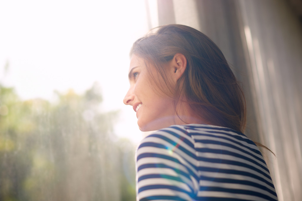 Cropped shot of a beautiful young woman bathed in window light