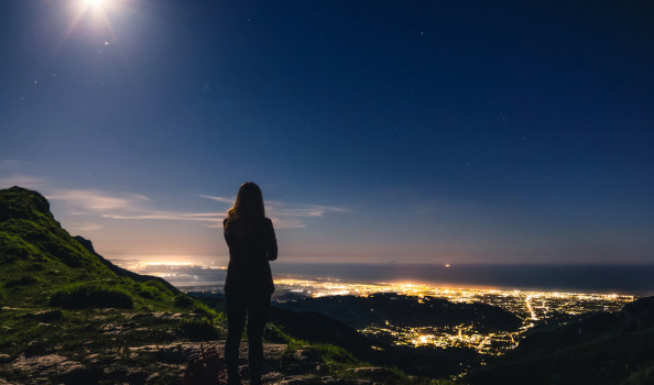 Girl on top of mountain admiring the view