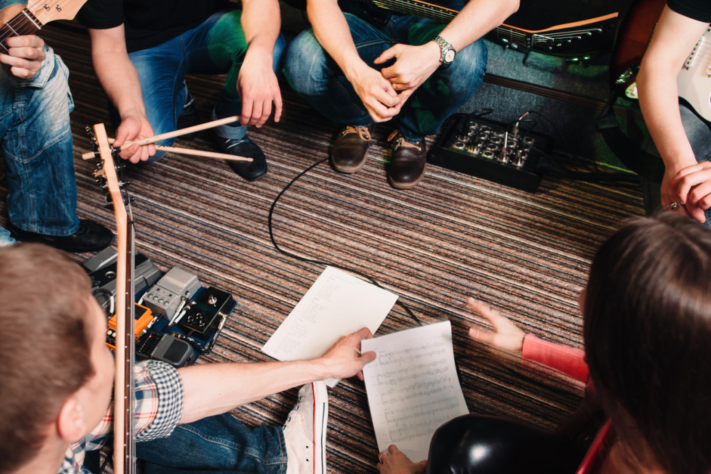 Musicians discussing new song top view