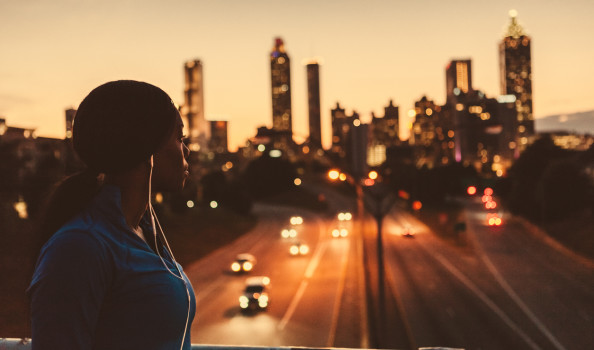 female runner looking out to the skyline