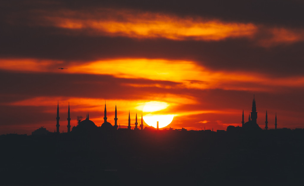 Sunset with sun behind silhouette in Istanbul,Turkey