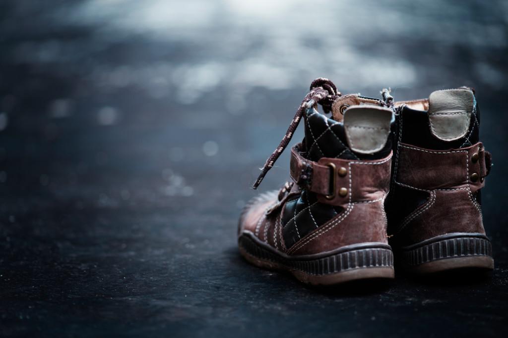 Hiking boots on dark floor