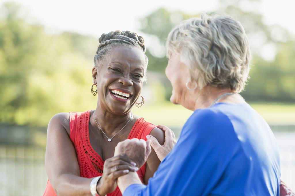 Senior multi-racial women, best friends, laughing