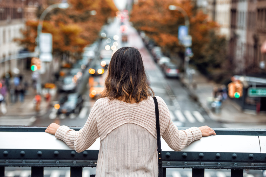 Beautiful woman travel and looking at New York City street