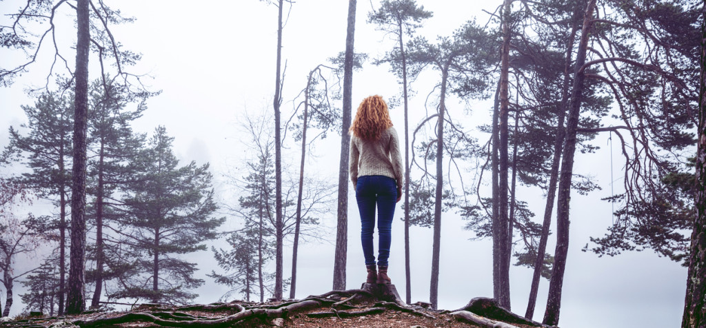 Spooky woman in mountain inside the forest