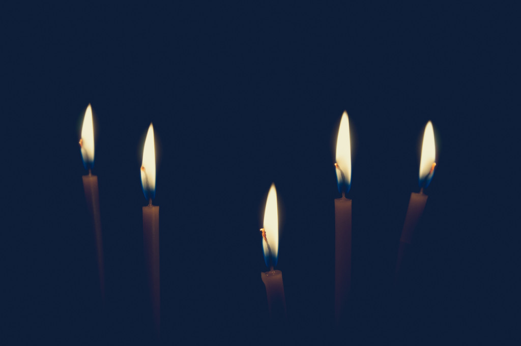 Candles light in the dark.