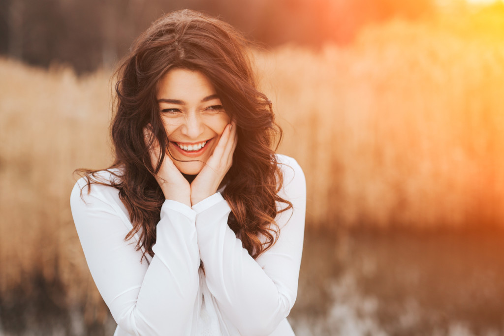 beautiful sunny portrait of a girl wearing white clothes.