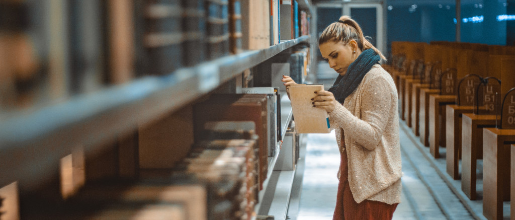 female student looking for books