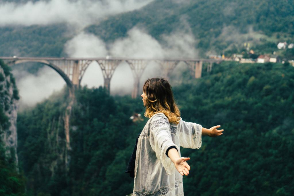 Woman near the bridge on Tara river