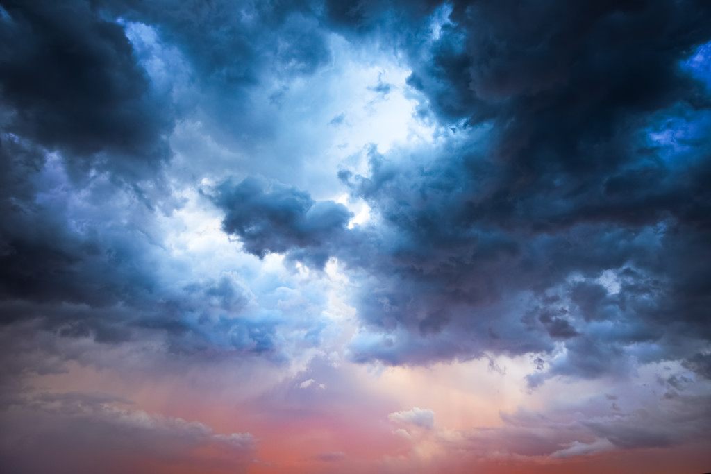 Beautiful storm clouds on a summer night with pinks and blues.