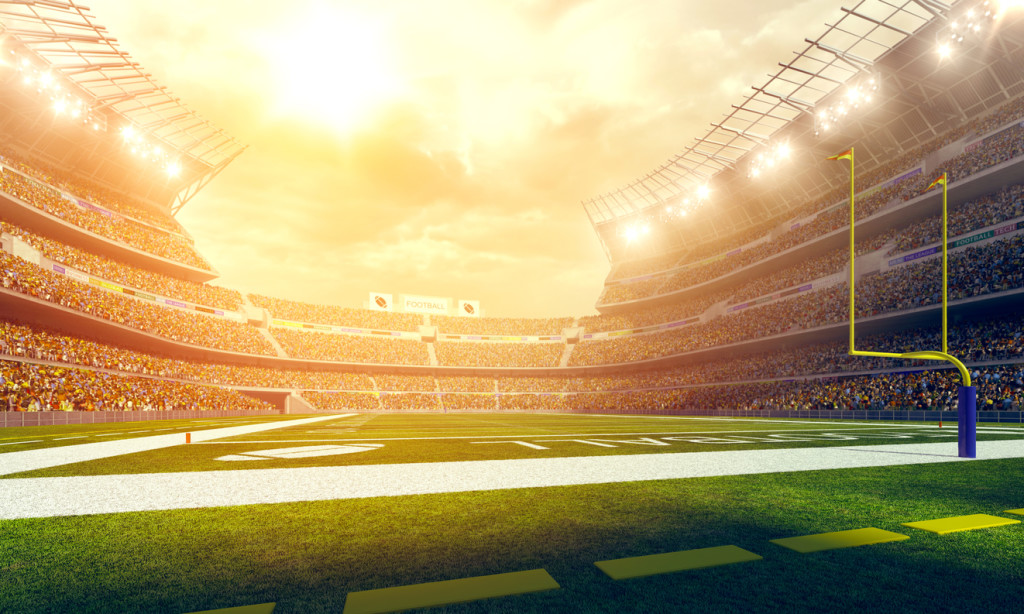 American football stadium wide angle with sun flare