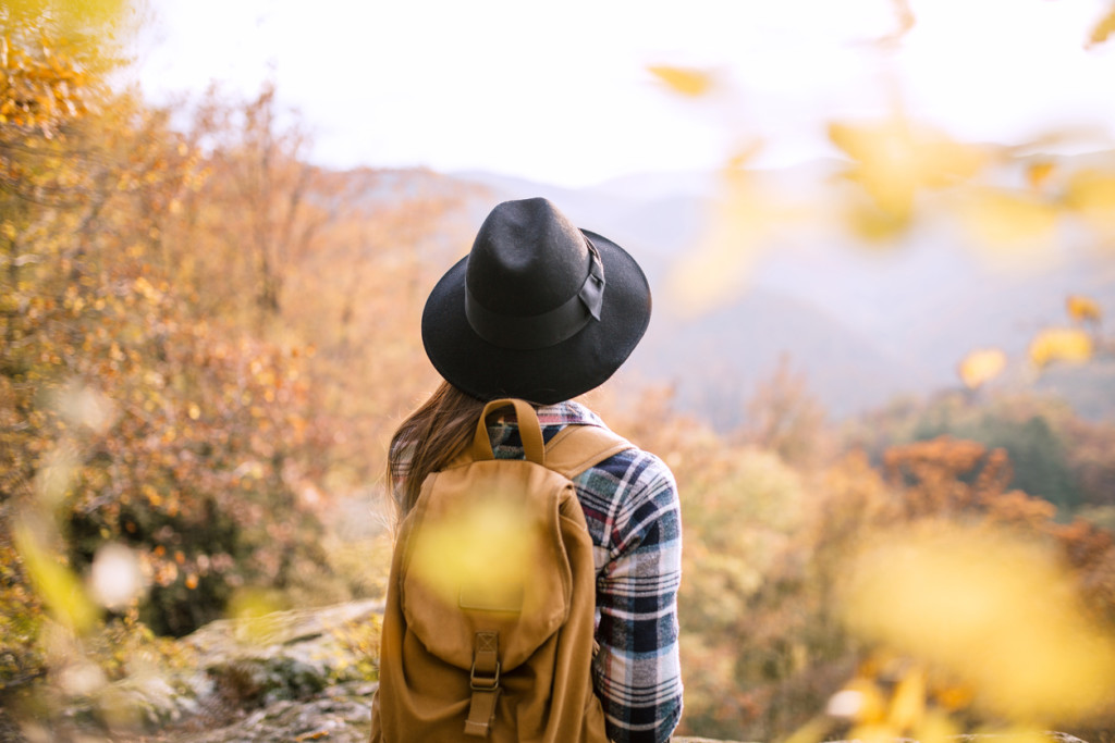 Woman with backpack at viewpoint
