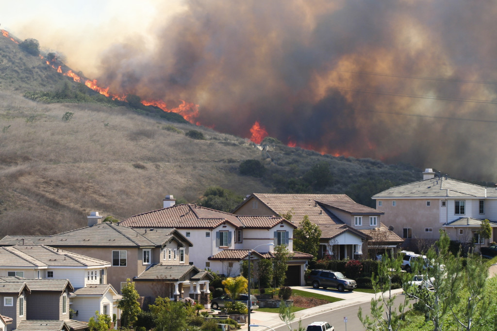 Southern California brush fire near houses