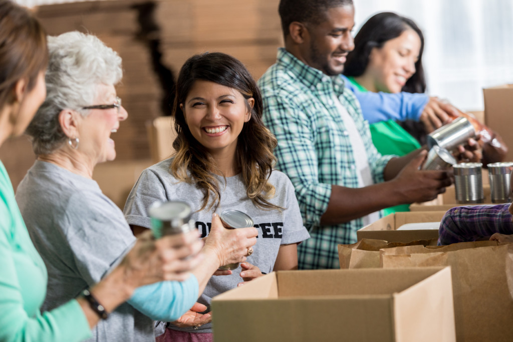 Volunteers pack canned goods into boxes during food drive