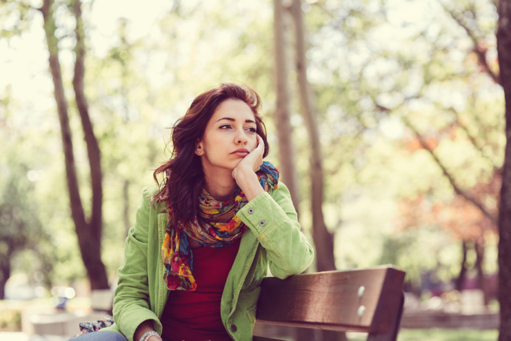 Thoughtful woman in the park