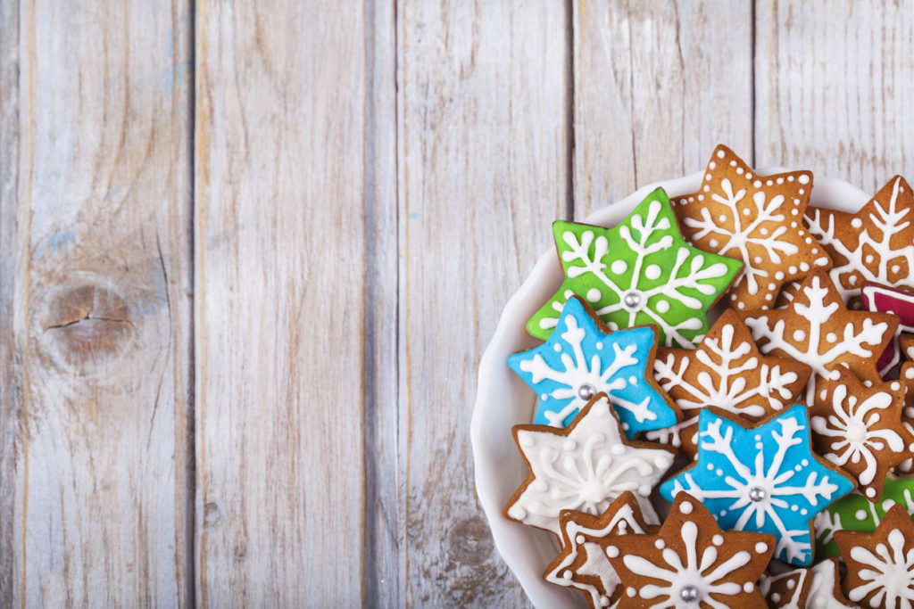 Christmas Gingerbread Cookies Stars on wooden table.
