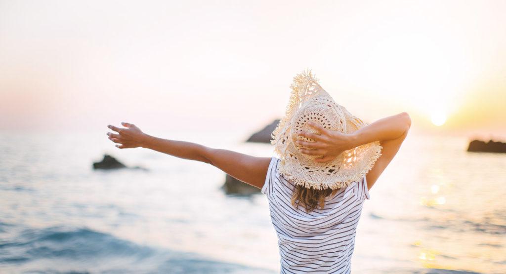 Beautiful woman on hot summer day enjoying on beach