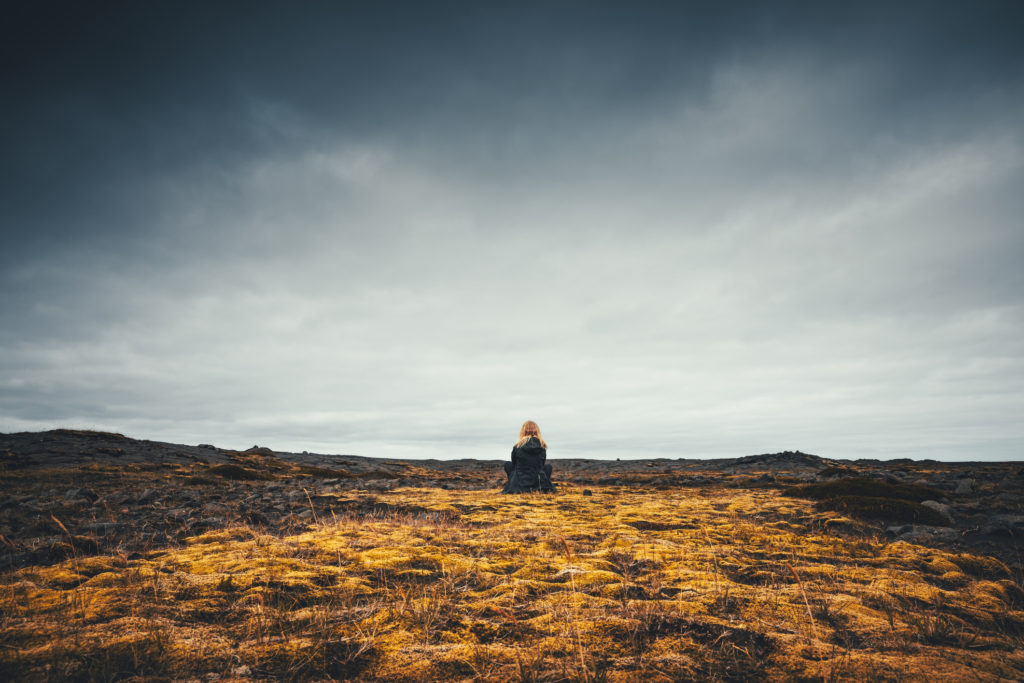 Young woman enjoying in Icelandic wilderness.