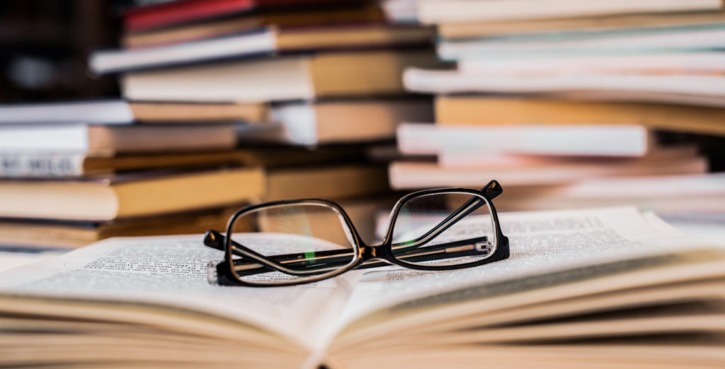 Reading glasses on a book. Close-up