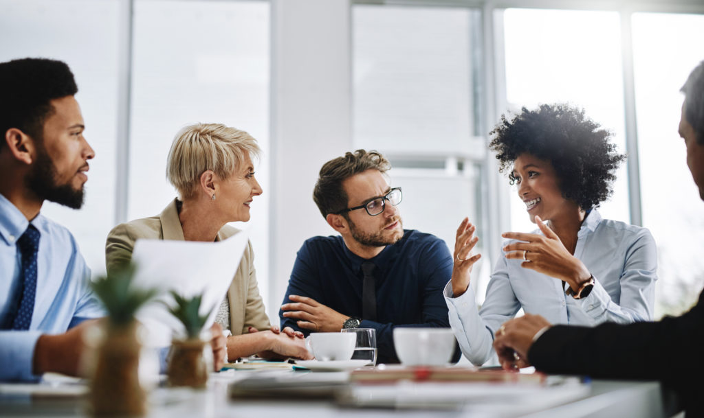 Shot of a group of businesspeople sitting together in a meeting