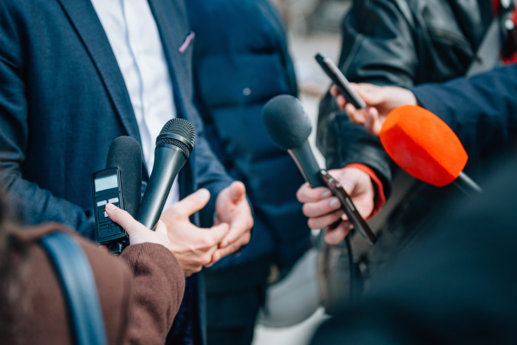 Interviewing businessman or politician, press conference