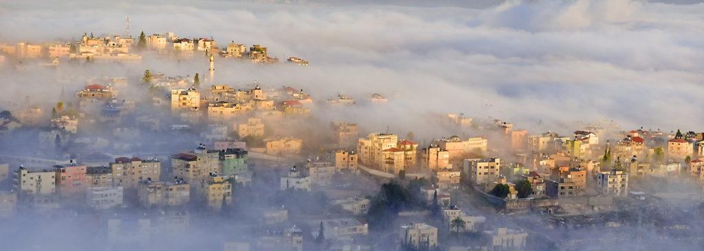 biblical village Cana of Galilee ( Kafr Kanna ) in morning fog, Nazareth in Israel