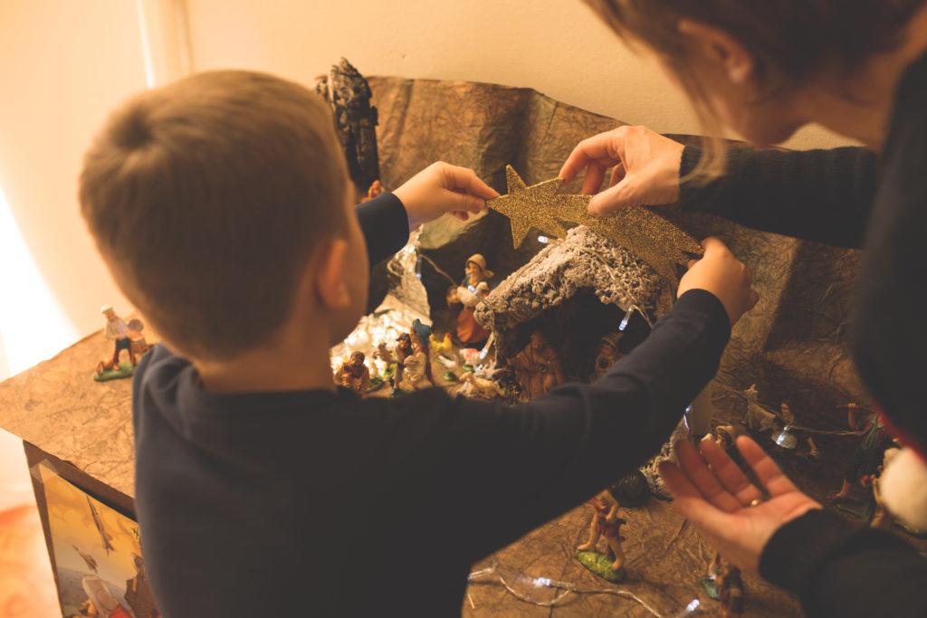 Christmas - Mother and son making nativity scene