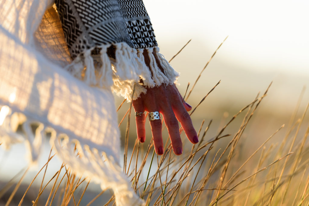 Woman hand caressing grass