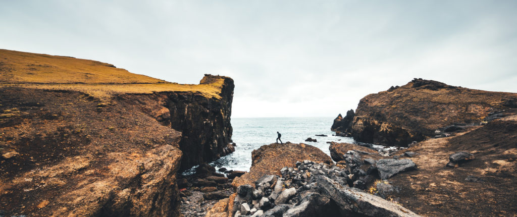 Man hiking on Valahnukur cliffs in Iceland.