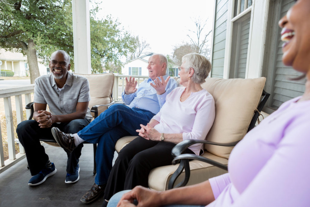 Group of neighbors enjoy one another's company