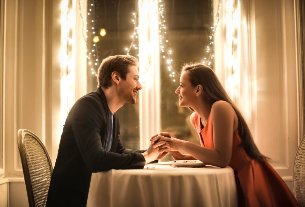 Sweet couple having a romantic dinner in an elegant restaurant