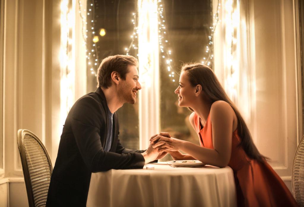 Sweet couple having a romantic dinner in an elegant restaurant