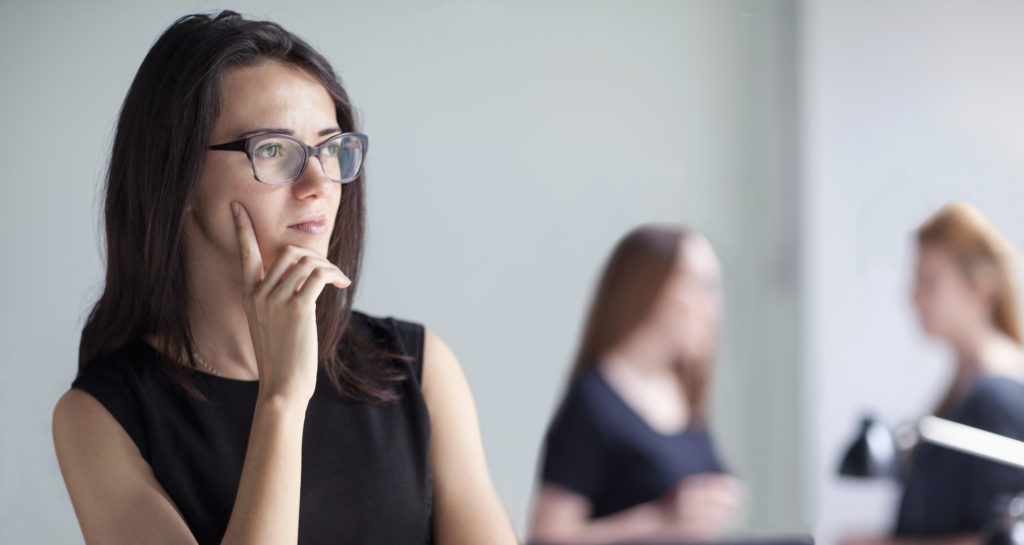 Young woman thinking in business office