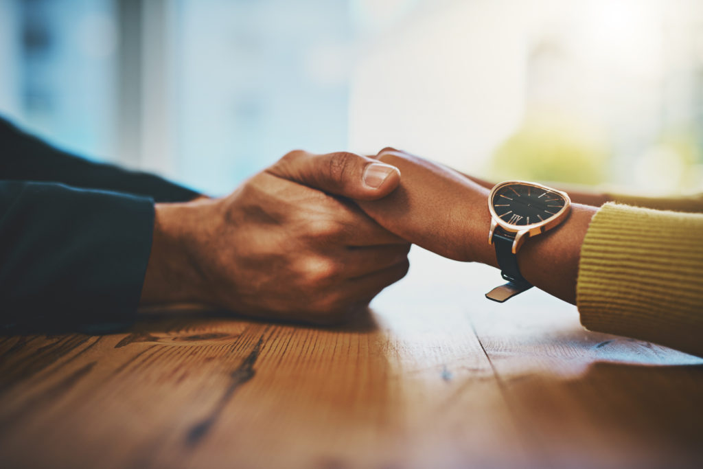 couple holding hands, redeeming marriage through hard work
