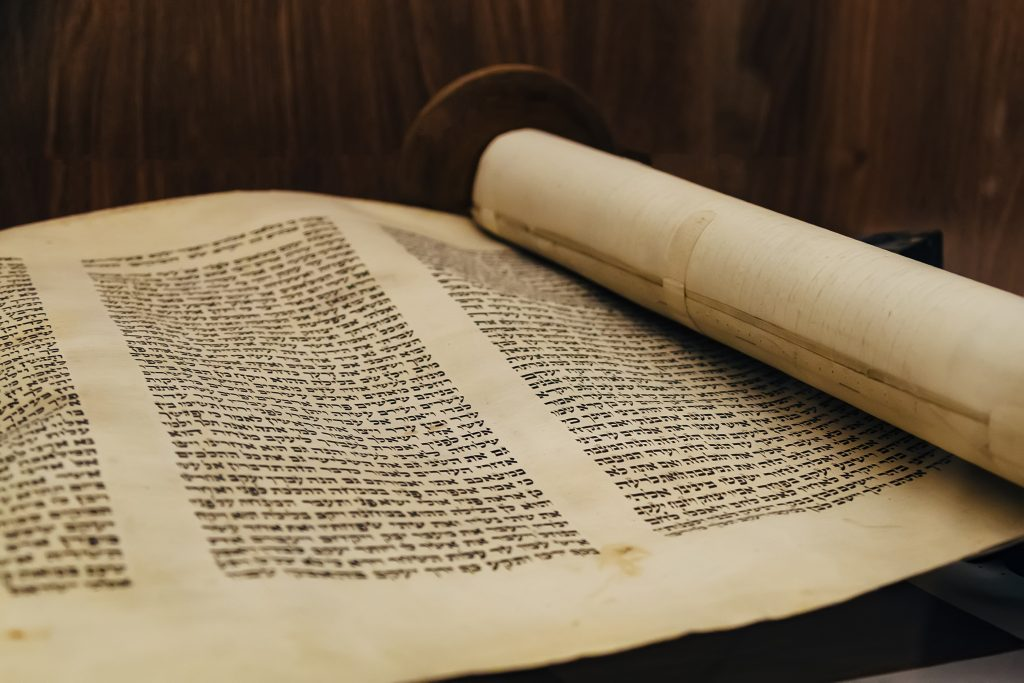 Hebrew religious handwritten Torah parchment scroll.