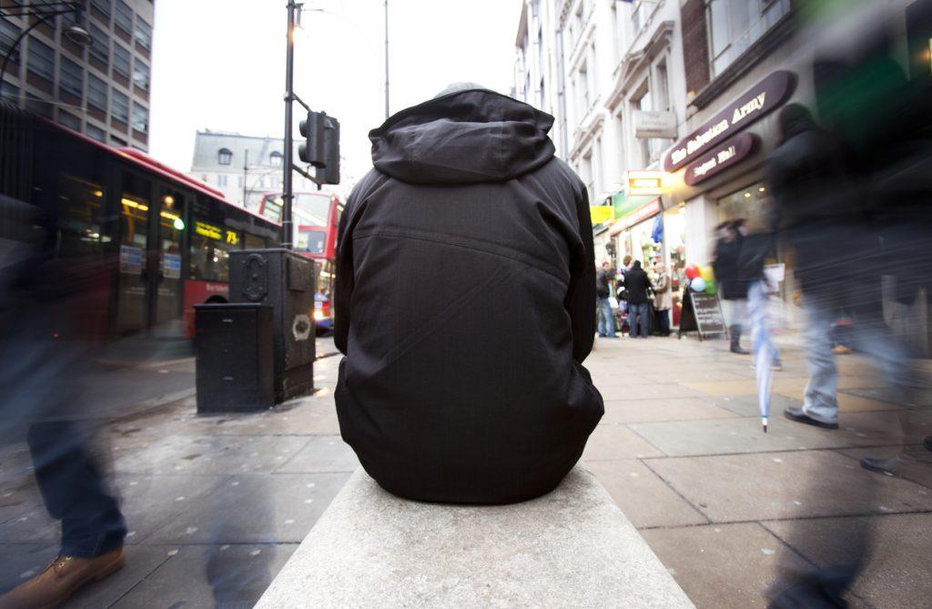 Bystanders ignore homeless man