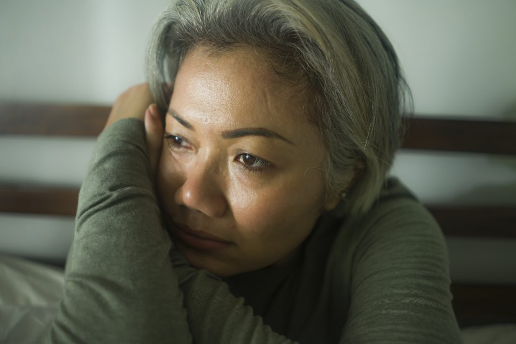 maturmiddle aged woman with grey hair sad and depressed