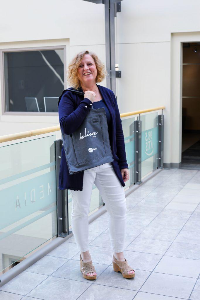 Rosey Brausen wearing Believe bag